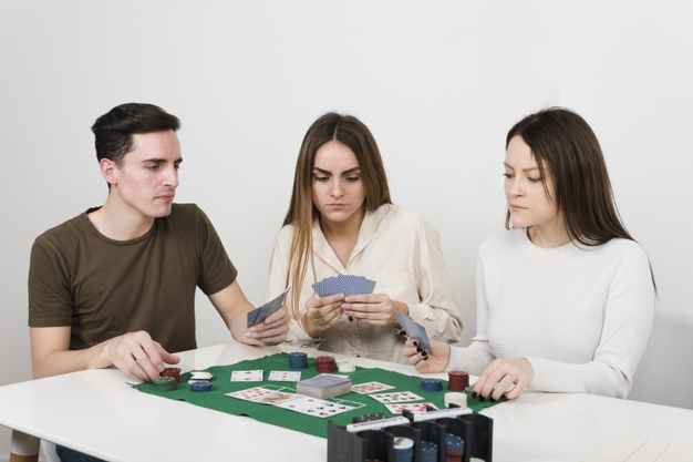 front-view-friends-playing-poker_23-2148234851